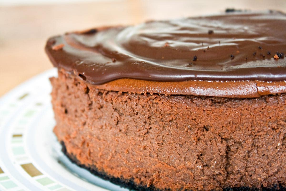 Rich, decadent deep chocolate cheesecake covered in rich chocolate ...