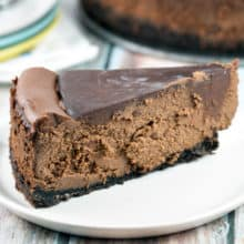 Rich, decadent deep chocolate cheesecake covered in rich chocolate ganache. No water bath necessary! {Bunsen Burner Bakery}