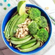 Thai Peanut Noodle Stir Fry: broccoli, sugar snap peas, snow peas, and noodles covered in a Thai-inspired peanut and lime sauce. The perfect quick and easy vegan weeknight dinner. {Bunsen Burner Bakery}