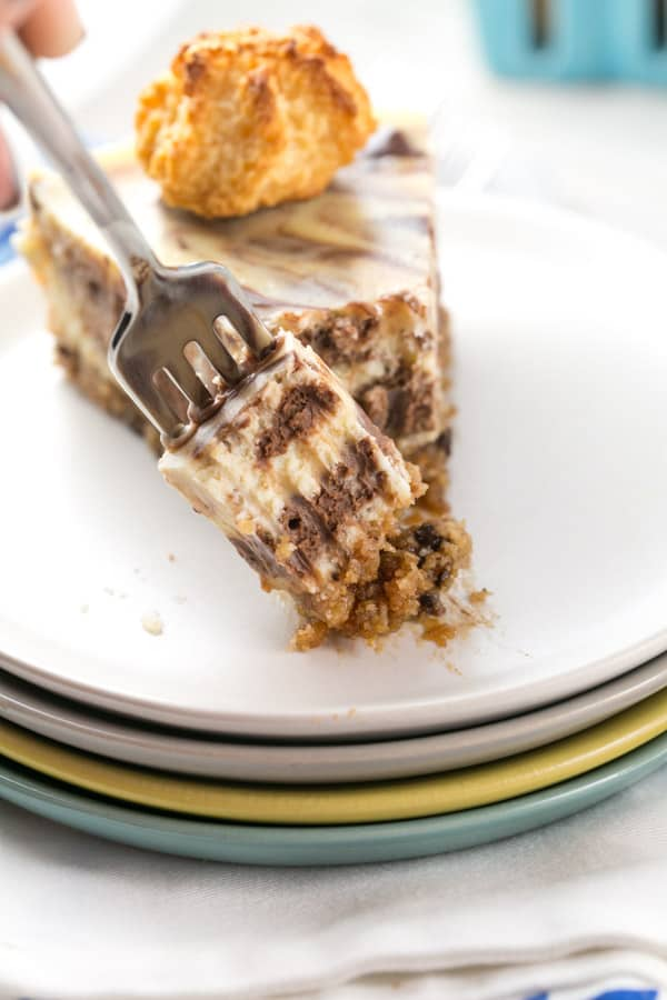 Macaroon Crust Cheesecake: rich chocolate swirled cheesecake with a coconut macaroon crust. Perfect for Passover seders or as a gluten free dessert option! {Bunsen Burner Bakery} #cheesecake #passover #glutenfree