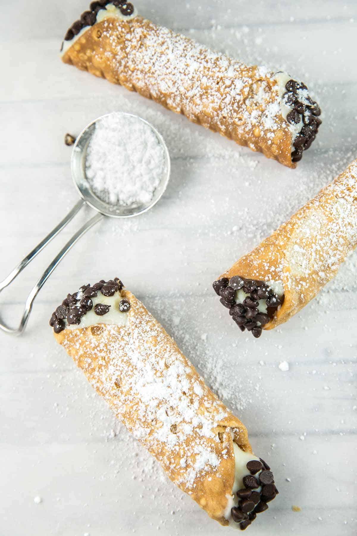 Homemade Cannoli Recipe: traditional cannoli with deep fried shells an a smooth ricotta filling. As good as Italian bakery! {bunsenburnerbakery.com} #cannoli #italian #italiandesserts