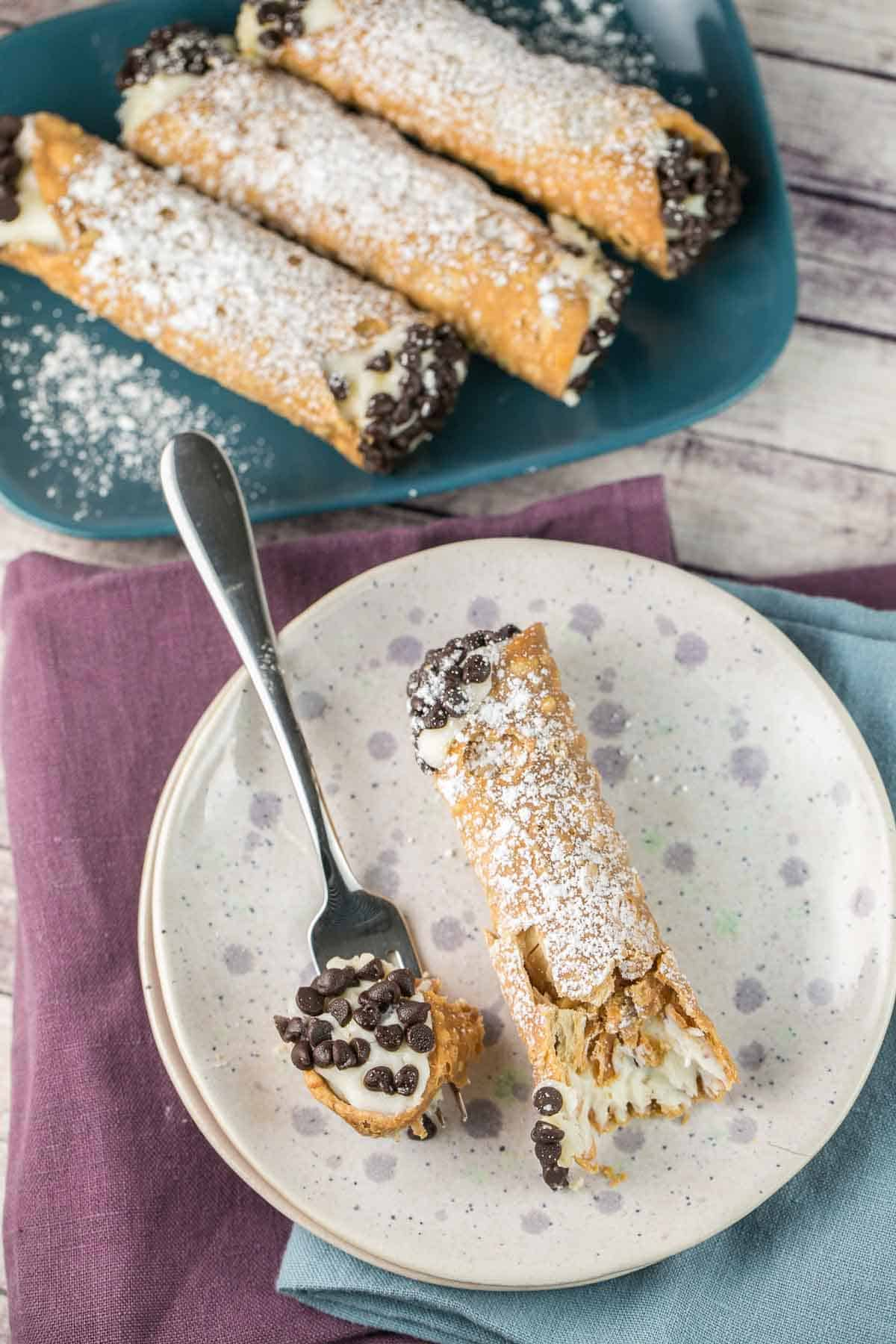 Homemade Cannoli Recipe: traditional cannoli with deep fried shells an a smooth ricotta filling. As good as Italian bakery! {bunsenburnerbakery.com} #cannoli #italian #italiandesserts