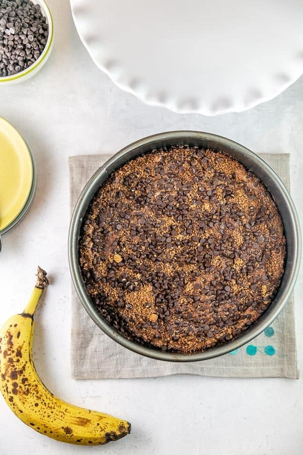 banana coffee cake with chocolate chip streusel in a springform pan