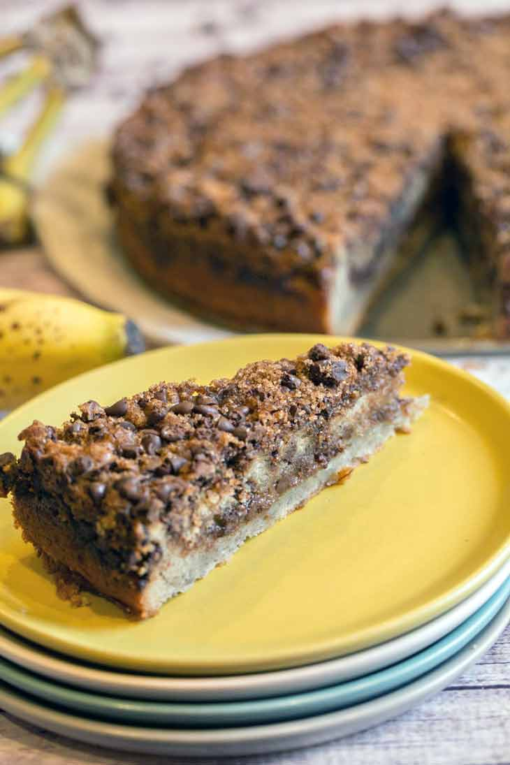 Banana Chocolate Chip Crumb Cake: extra moist banana cake with two layers of chocolate cinnamon streusel. A guaranteed hit for breakfast, brunch, or dessert! {Bunsen Burner Bakery}