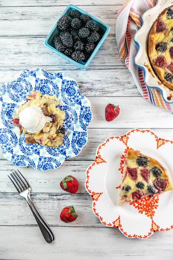 berry clafoutis served two ways, cut in a wedge or spooned onto a plate and topped with a scoop of ice cream