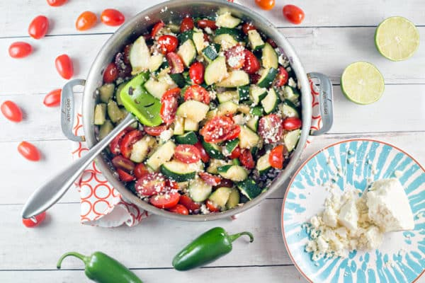 Mexican Zucchini: spice up your summer zucchini with tomatoes, red onion, jalapenos, cilantro, and cotija cheese. It's all your favorite Mexican flavors, paired with health fresh zucchini. Vegetarian + Gluten Free! {Bunsen Burner Bakery}