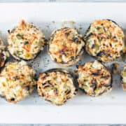 Crab Stuffed Mushrooms: perfect on the grill or baked in the oven, these make-ahead crab stuffed mushrooms are a perfect side or appetizer for your next party. No breadcrumb filler means they're gluten free, too! {Bunsen Burner Bakery}