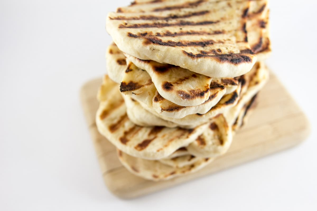 Garlic Naan: homemade naan is so much easier than you think!  Soft, slightly chewy, and flavored with garlic, make a big batch and freeze the rest for later. {Bunsen Burner Bakery}