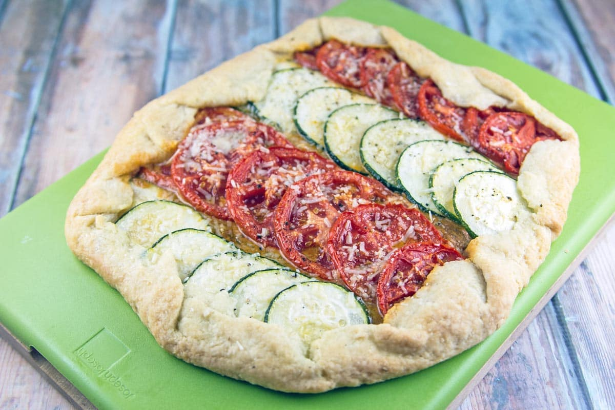 Tomato and Zucchini Galette: a rustic pie with sun-dried tomato pesto, highlighting fresh summer tomatoes and zucchinis. {Bunsen Burner Bakery}