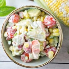 Corn and Tomato Crab Salad: filled with fresh summer corn, tomatoes, and avocado, this crab salad is a great alternative to standard picnic and BBQ sides. {Bunsen Burner Bakery} #crab #corn #tomatoes #picnic #sides #summer