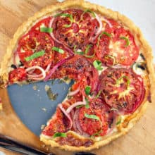 Healthier Tomato Pie: this not-so-souther tomato pie capitalizes on fresh tomato flavor with minimal mayo, keeping a delicious crispy crust. {Bunsen Burner Bakery}