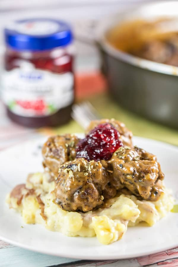 Swedish Meatballs: The ultimate comfort food. Homemade meatballs with thick gravy and lingonberry jam, served over egg noodles or mashed potatoes. {Bunsen Burner Bakery} #swedishmeatballs #dinner #meatballs