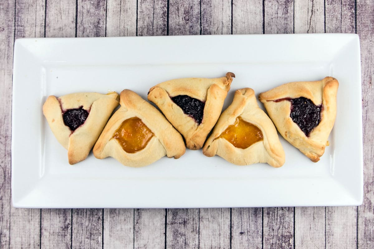 The great hamantaschen debate: cakey or cookie? Crunchy or soft? Folded or pinched? Traditional or modern? Try this one on for size. {Bunsen Burner Bakery}