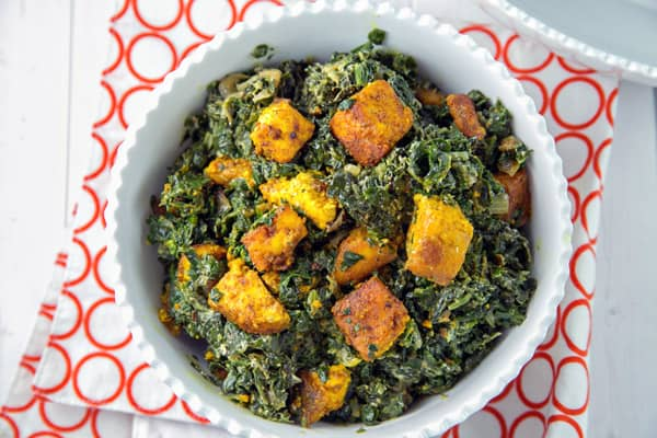 saag paneer with homemade paneer in a white bowl