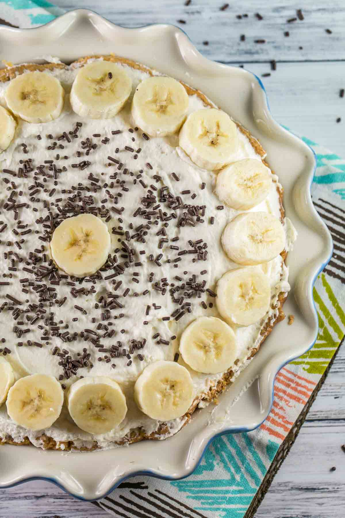 Old Fashioned Banana Cream Pie: A traditional, homemade diner-style pie - banana-infused pastry cream, sliced fresh bananas, and sky-high whipped cream. {bunseburnerbakery.com} #pie #bananacreampie