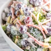 Extra Crunchy Broccoli Salad: easy summer picnic broccoli salad with almonds, bacon, and grapes. Packed full of flavor without all the guilt - no mayo necessary. {bunsenburnerbakery.com} #salad #broccolisalad #picnic