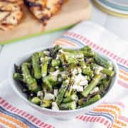 Grilled asparagus, tangy feta cheese, and a splash of lemon juice — grilled asparagus and feta salad is the perfect quick and easy early summer salad. {Bunsen Burner Bakery}