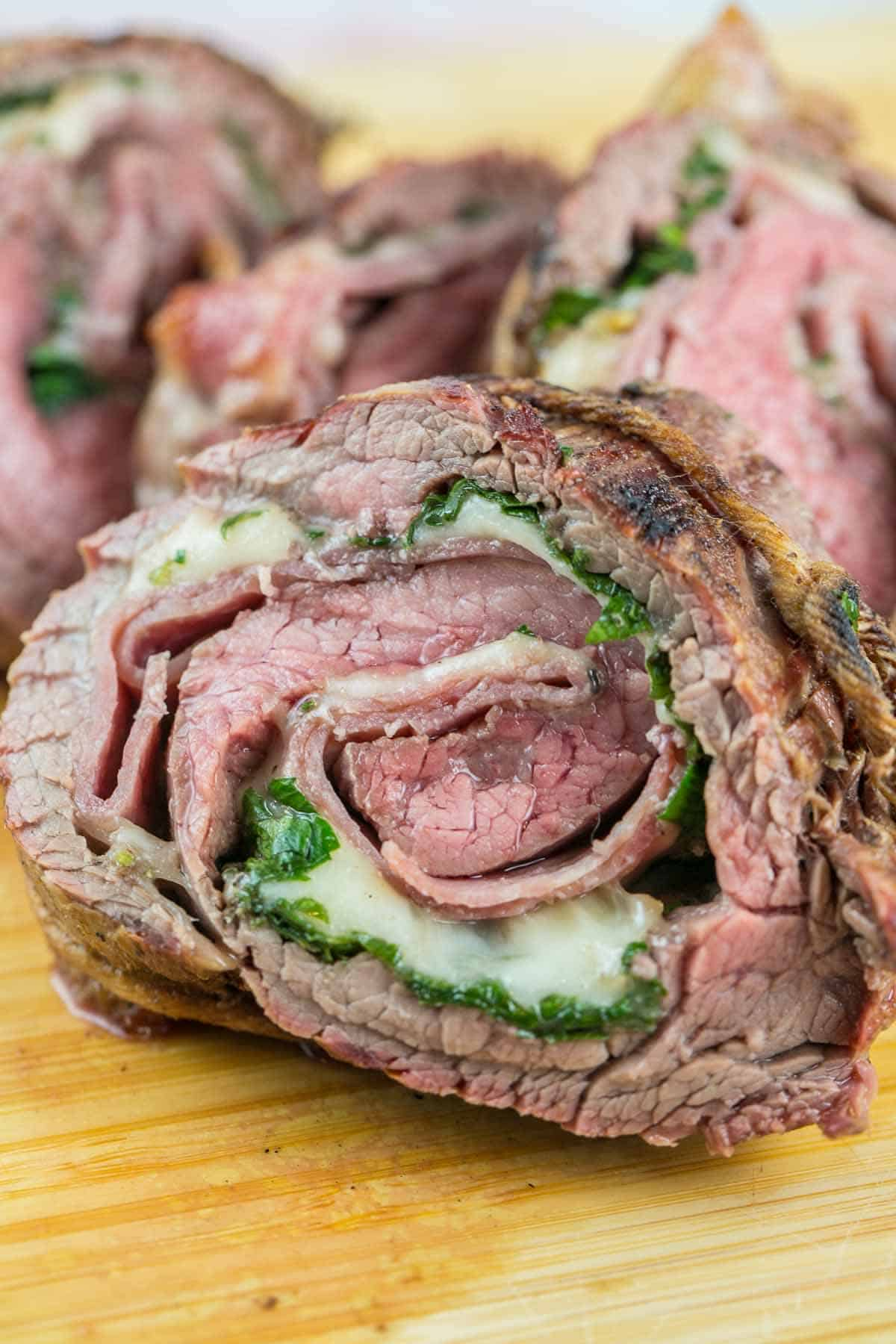 Italian Flank Steak Pinwheels: flank steak stuffed with salami and provolone, rolled tightly, and grilled. Go ahead, impress your friends - they don't have to know how easy this is. {Bunsen Burner Bakery} #flanksteak #steakpinwheels #grilling #dinner