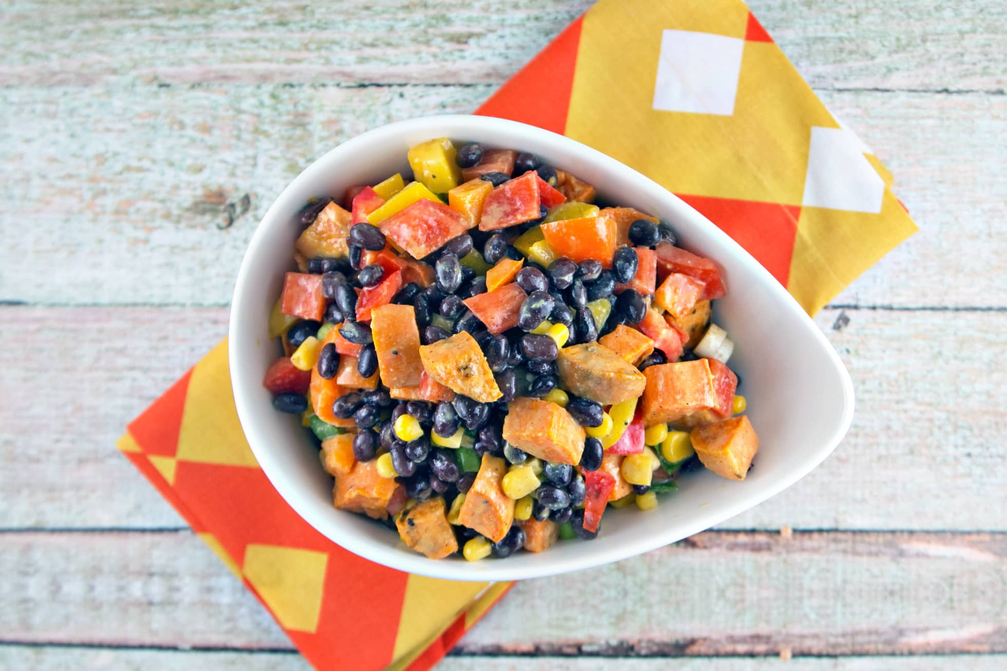 Sweet Potato Black Bean Salad: the best salad of summer. Buttery sweet potatoes, crunchy peppers, tangy mustard-lime dressing. {Bunsen Burner Bakery}