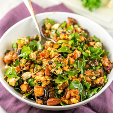 Roasted Eggplant and Smoked Almond Dip: Think outside the typical dip box, with this delicious gluten free and vegetarian dip made from roasted eggplants, smoked almonds, goat cheese, and parsley with a honey vinegar dressing. Also delicious as a side or a salad! #bunsenburnerbakery #dip #salad #glutenfree #partyfood