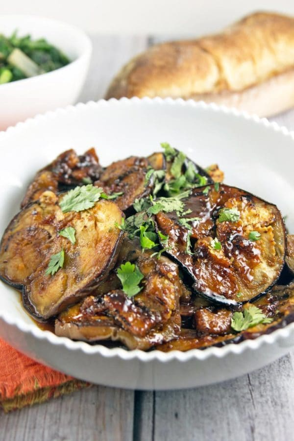 sweet and spicy honey glazed moroccan eggplant in a white serving bowl