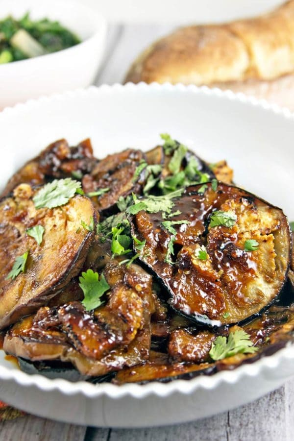 close up view of harissa and honey glazed moroccan eggplant with a sprinkle of cilantro