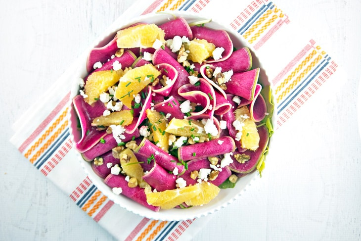 Watermelon Radish and Citrus Salad: thinly sliced watermelon radishes paired with winter citrus, candied walnuts, and tangy goat cheese make a beautiful spring salad. {Bunsen Burner Bakery}