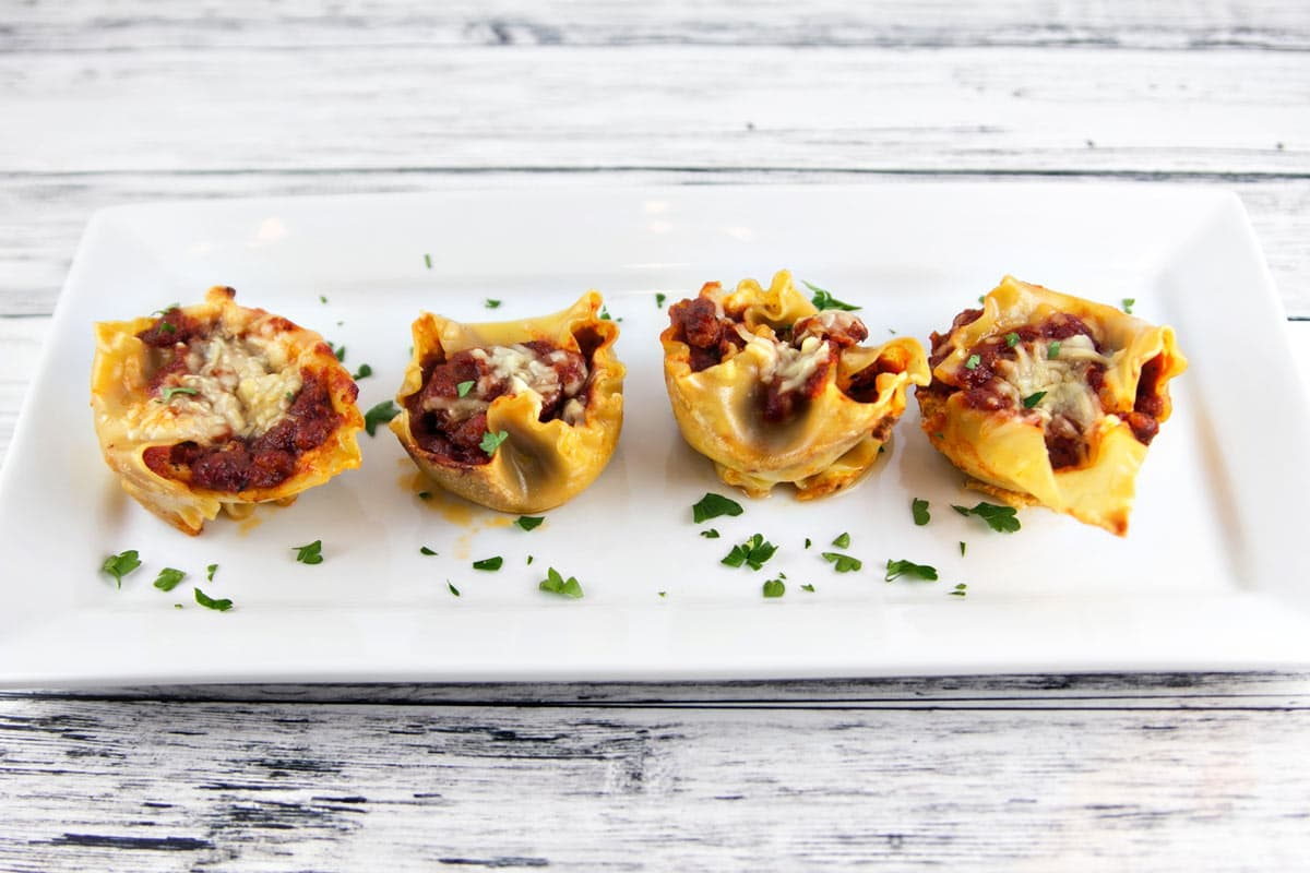 Individual sausage lasagna cups, filled with ricotta cheese,..