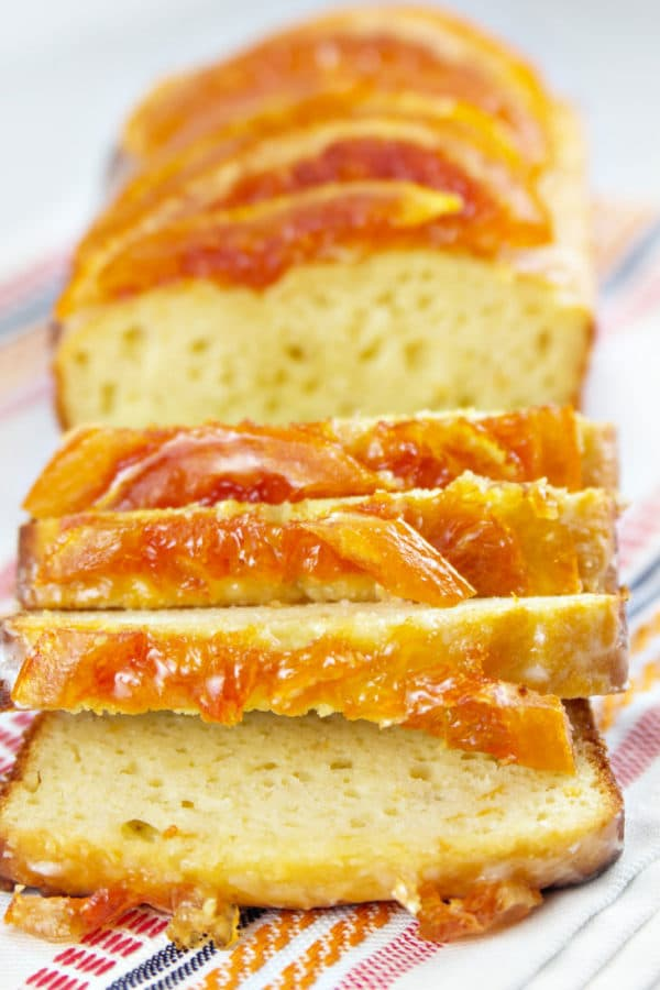 Candied Grapefruit Quick Bread: Yogurt quick bread loaded with grapefruit juice and zest, then topped with sugary grapefruit glaze and candied grapefruit. The ultimate grapefruit bread! {Bunsen Burner Bakery}