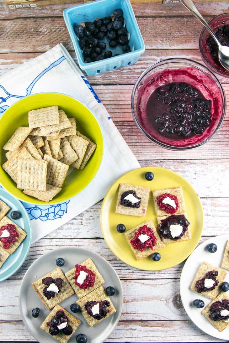 TriBerryTriscuits (Triple Berry Herb Cracker Bites): The perfect summer entertaining appetizer bites -- easy homemade berry compote paired with fresh herbs, TRISCUIT crackers, and a dollop of honey goat cheese. {Bunsen Burner Bakery}