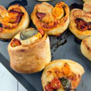 Rustic Pizza Rolls: A quick food processor pizza dough, filled with fresh basil and cherry tomatoes.  A perfectly portable grown-up version of pizza bites.  {Bunsen Burner Bakery}