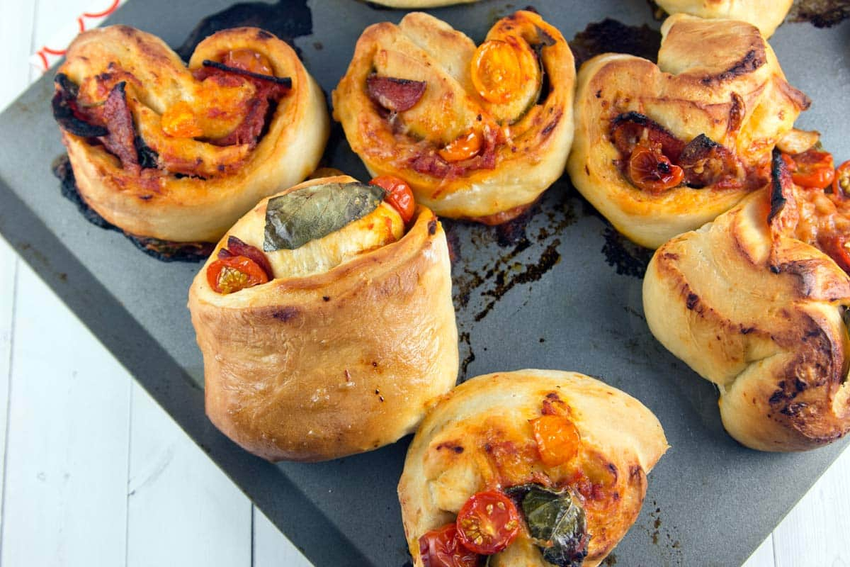 Rustic Pizza Rolls: A quick food processor pizza dough, filledwith fresh basil and cherry tomatoes. A perfectly portable grown-up version of pizza bites. {Bunsen Burner Bakery}