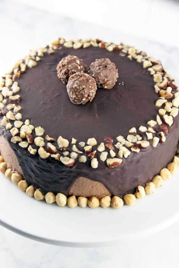Chocolate Hazelnut Cake: two layers of rich chocolate cake, sandwiched between layers of fluffy Nutella buttercream, topped with chocolate ganache and chopped hazelnuts.  {Bunsen Burner Bakery}