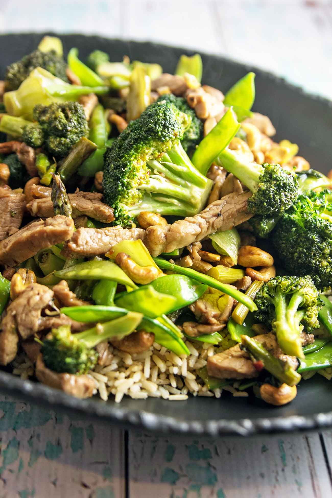 Pork Stir Fry with Cashews: fresh vegetables, crunchy cashews, and marinated pork tenderloin. A delicious, vegetable-heavy dinner, on your table in under 30 minutes. {Bunsen Burner Bakery}