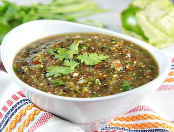 homemade roasted tomatillo salsa verde in a white bowl