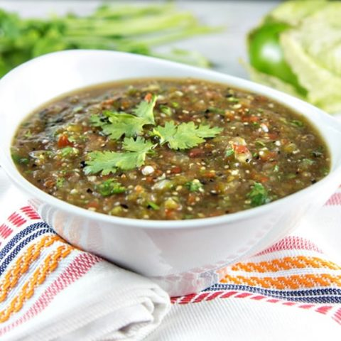 Roasted Tomato Salsa Verde: fire roasted tomatillos and cherry tomatoes pair beautifully with spicy jalapeno, onion, and garlic in this non-traditional salsa verde. A little sweet, a little tangy, a little spicy - all delicious. {Bunsen Burner Bakery}