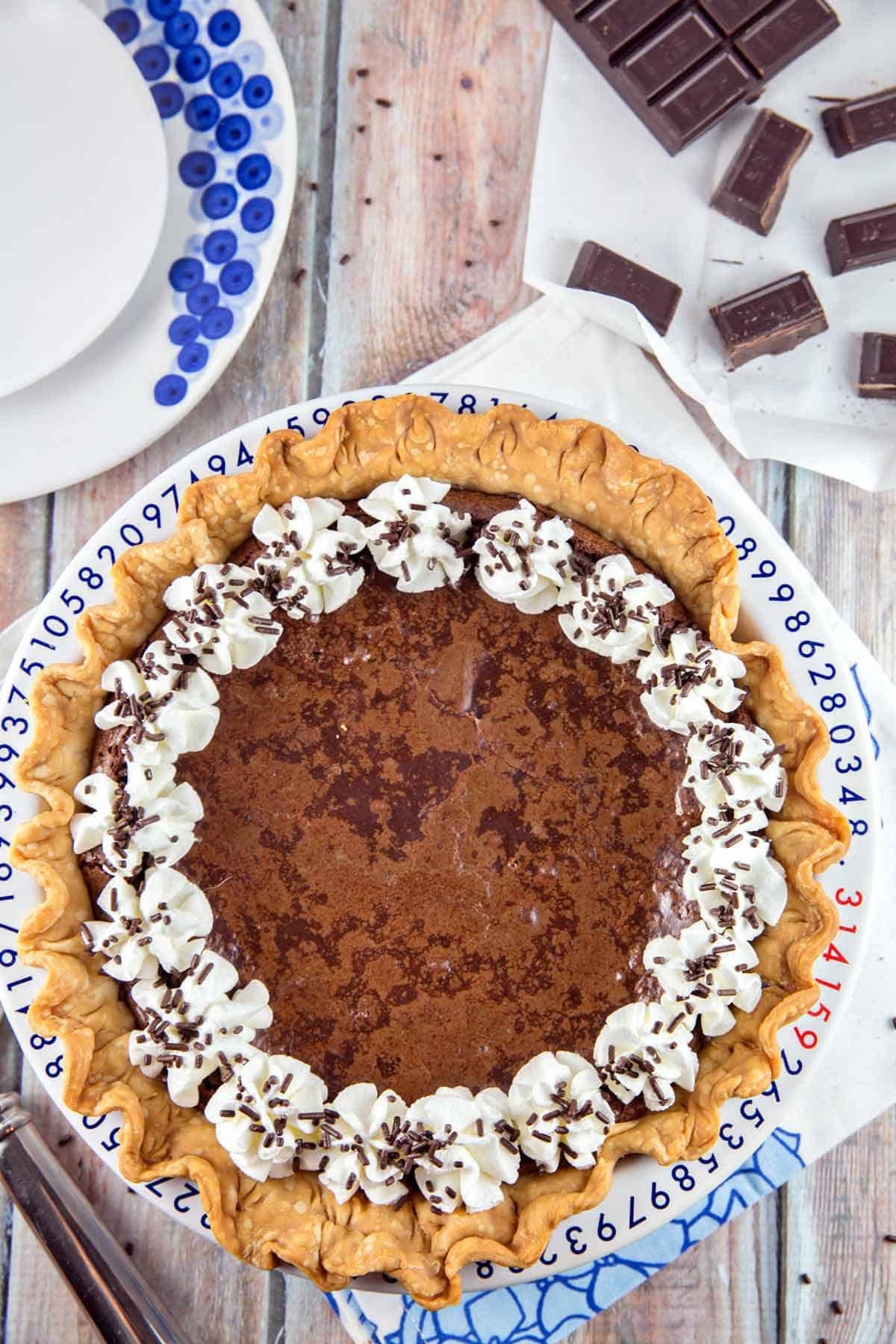 flourless chocolate brownie pie in a pi-themed pie dish