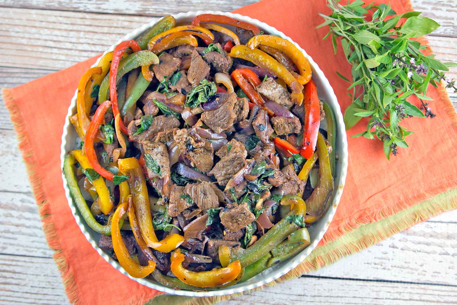 Thai Basil Beef: thinly sliced beef, bell peppers, and Thai basil combine into this fast, flavorful dish.  Make your own Thai takeout in under 15 minutes! {Bunsen Burner Bakery}