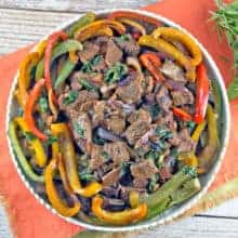 Thai Basil Beef: thinly sliced beef, bell peppers, and Thai basil combine in this fast, flavorful stir fry. Make your own Thai takeout in under 15 minutes! #bunsenburnerbakery #thaifood #glutenfree #stirfry #beefstirfry