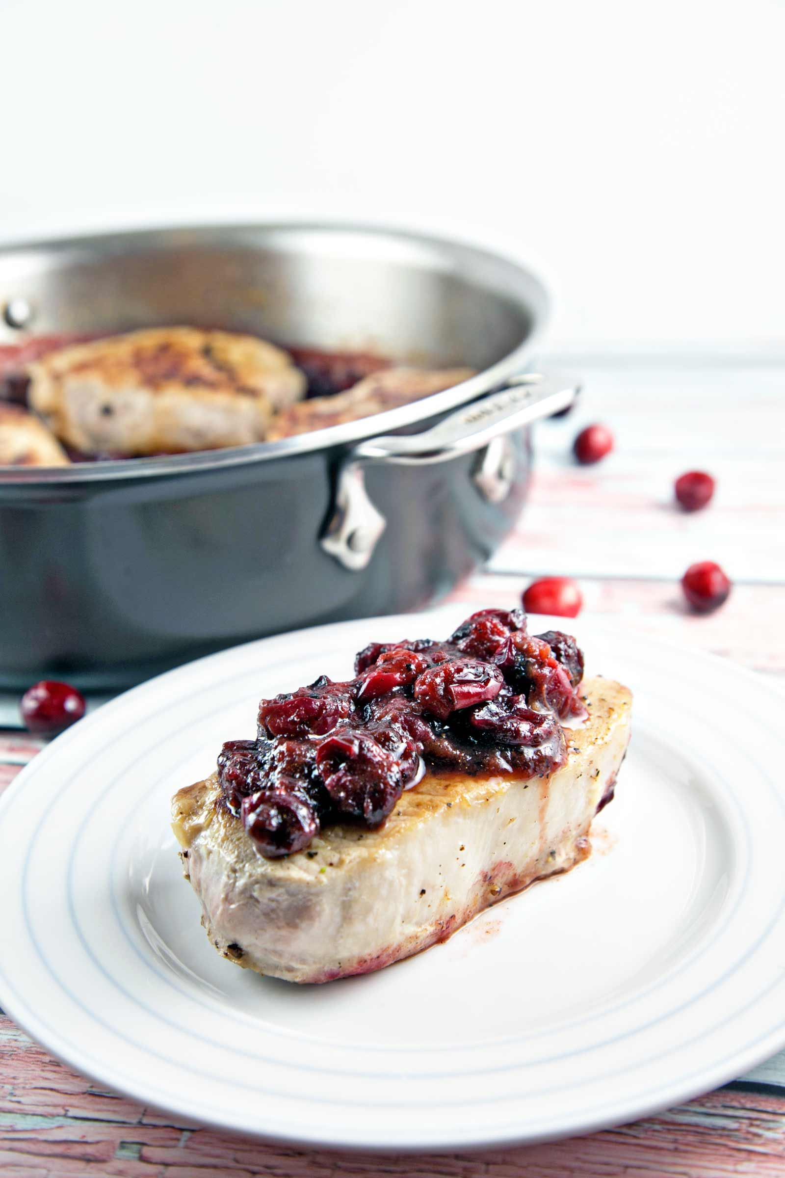 Cranberry Maple Pork Chops: perfectly pan seared pork chops with a cranberry maple mustard sauce. Plus, the top tip for keeping your pork chops juicy! {Bunsen Burner Bakery}