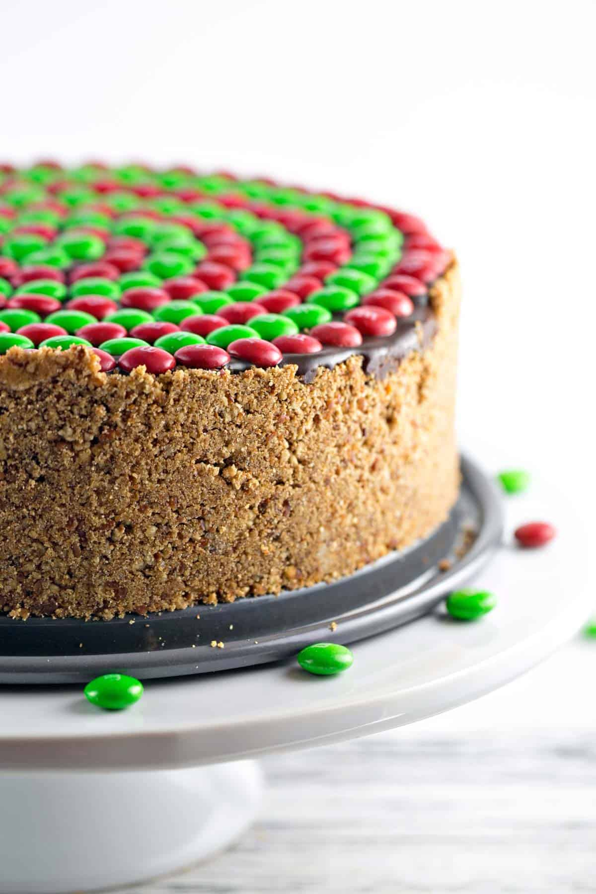 side view of a deep dish peanut butter pretzel pie showing the pretzel crust and m&m topping
