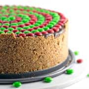 No Bake M&M'S® Pretzel Peanut Butter Pie: crispy pretzel crust, smooth whipped peanut butter filling, rich chocolate ganache, and crunchy M&Ms combine into the perfect easy pie. Perfect for holiday entertaining! #bunsenburnerbakery #peanutbutterpie #pie #pretzelcrust #christmas