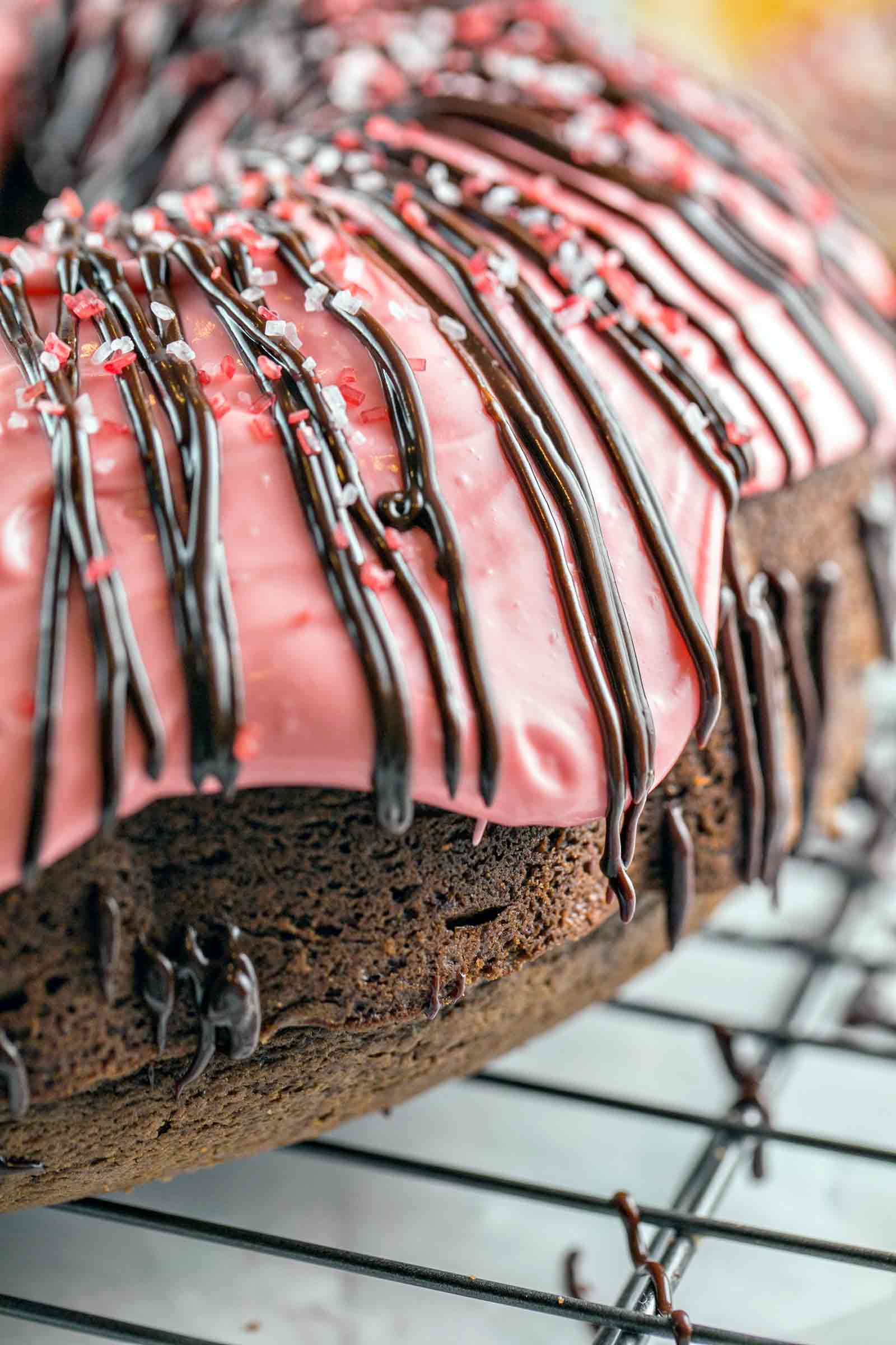 Peppermint Mocha Bundt Cake: rich chocolate cake, peppermint cream cheese frosting, and a chocolate ganache drizzle - this one-bowl mix by hand bunt cake is perfect for holiday entertaining. {Bunsen Burner Bakery}