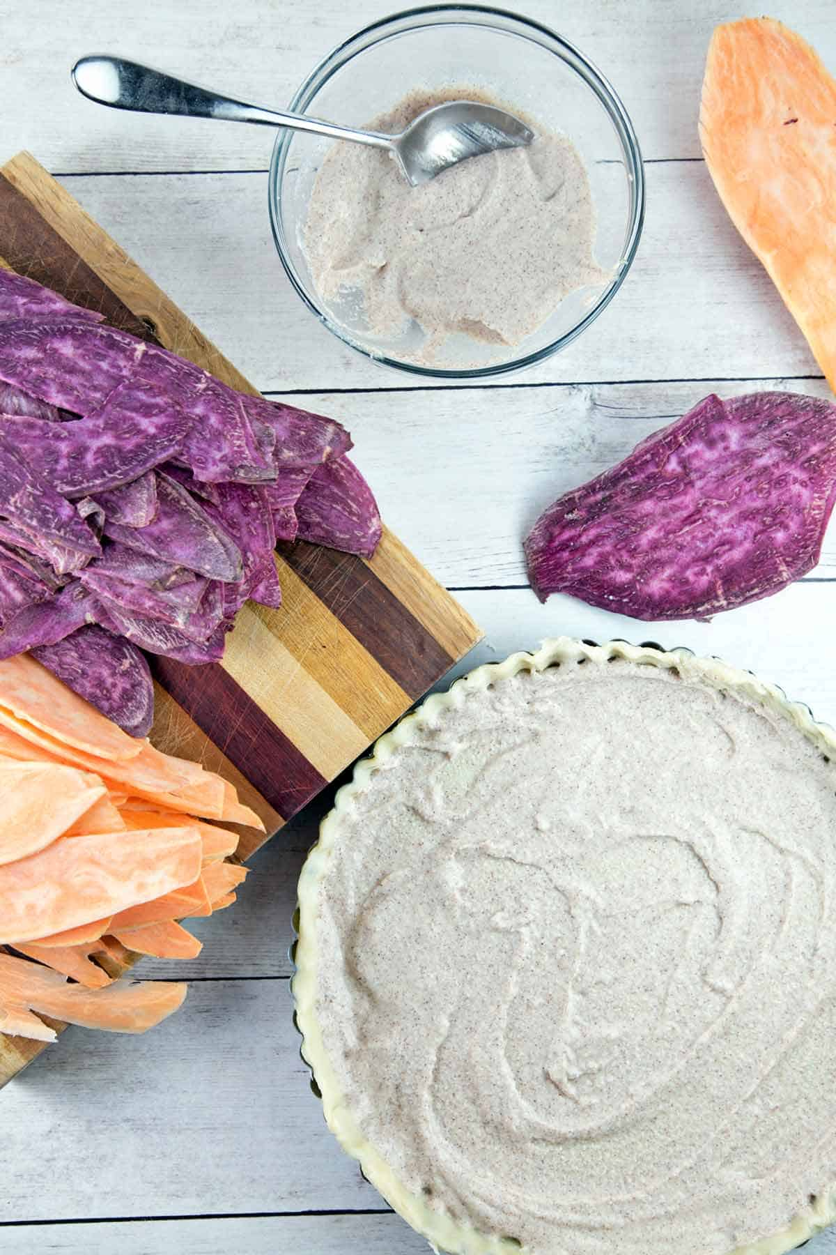 tart crust with a layer of whipped maple ricotta next to sliced orange and purple sweet potatoes