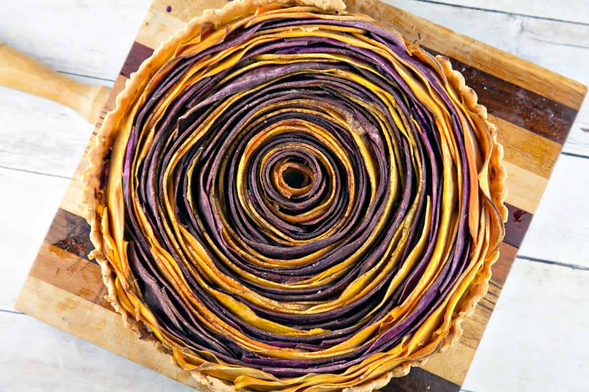 overhead view of a spiral sweet potato tart with concentric orange and purple circles
