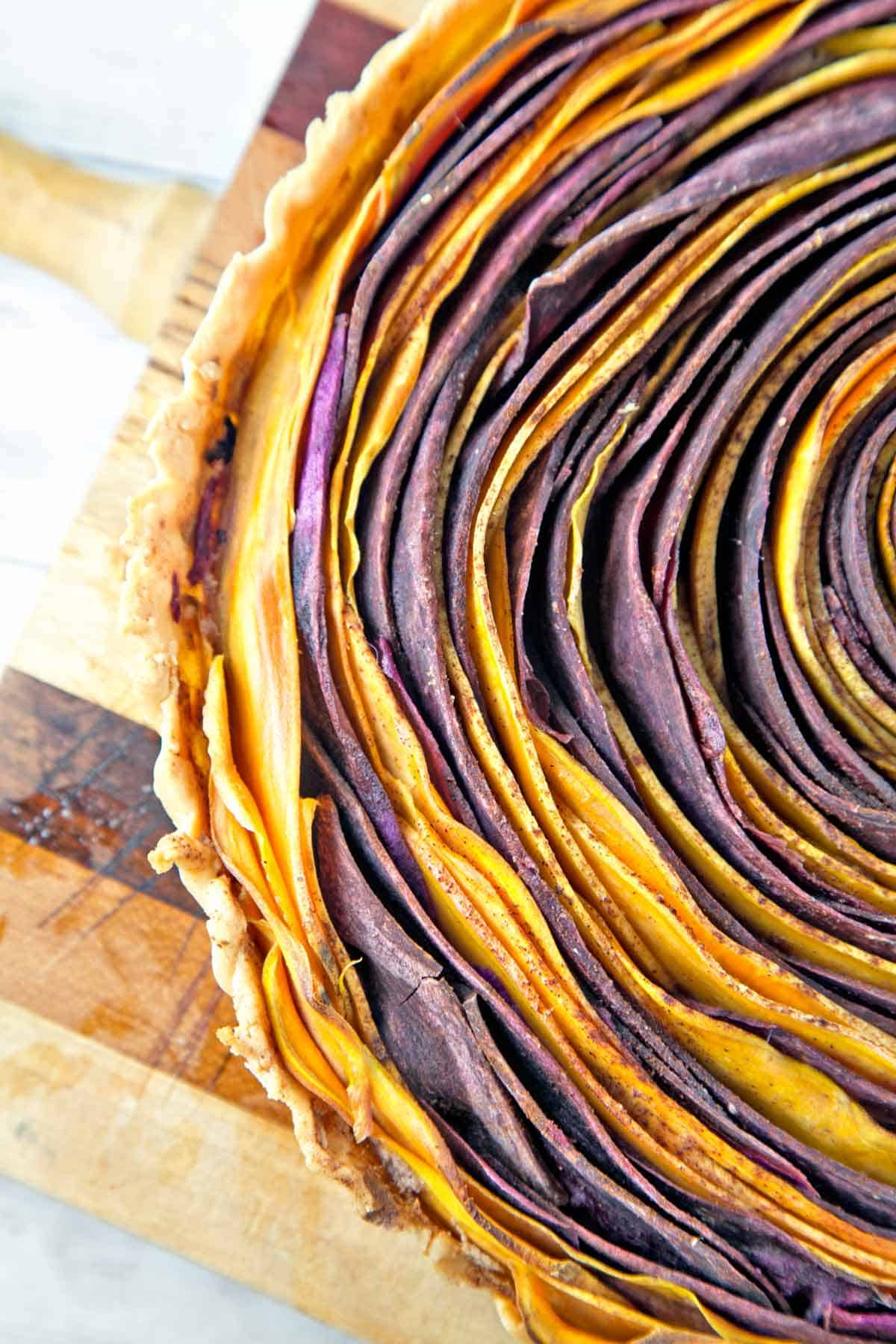 close up view of the circular layers of a baked sweet potato tart
