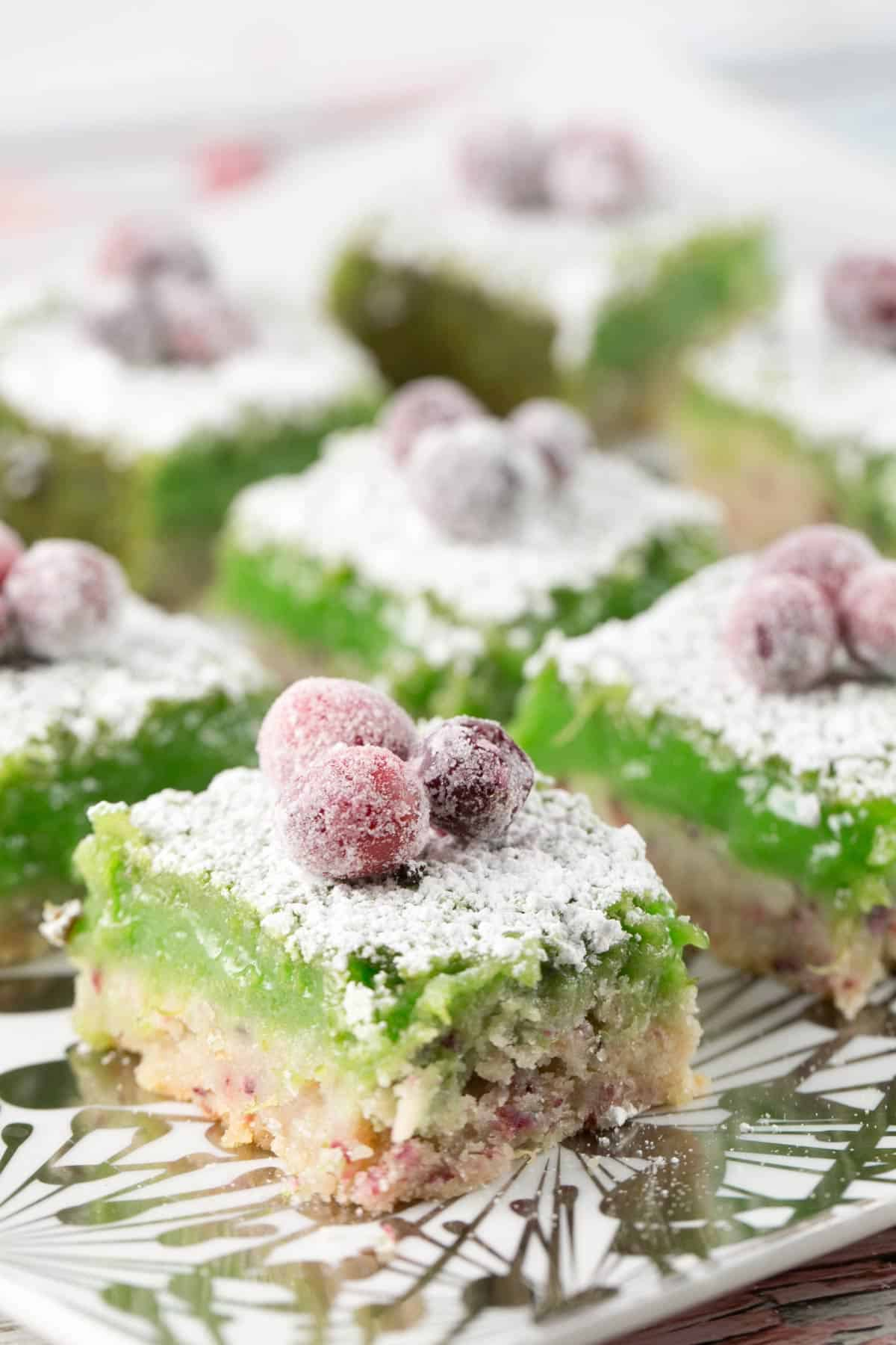 side view of cranberry lime bars showing the lime custard and shortbread crust
