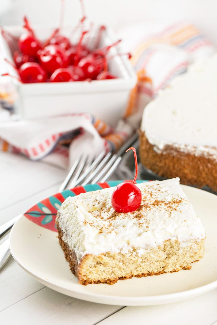 Tres Leches Cake: a simple vanilla sponge cake soaked in a sweet three-milk glaze and covered with fresh whipped cream. It's the perfect end to a spicy Mexican feast or your Cinco de Mayo celebrations! {Bunsen Burner Bakery}