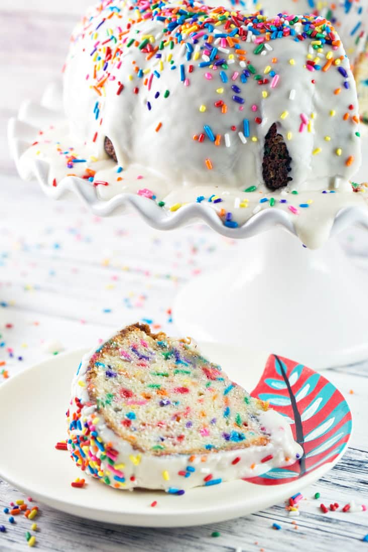 Funfetti Bundt Cake: Get ready to celebrate with this festive sprinkle-filled funfetti bundt cake! Everyone's favorite childhood flavor, baked from scratch. Perfect for birthdays, anniversaries, holidays, or any day that needs a little extra cheer! {Bunsen Burner Bakery}
