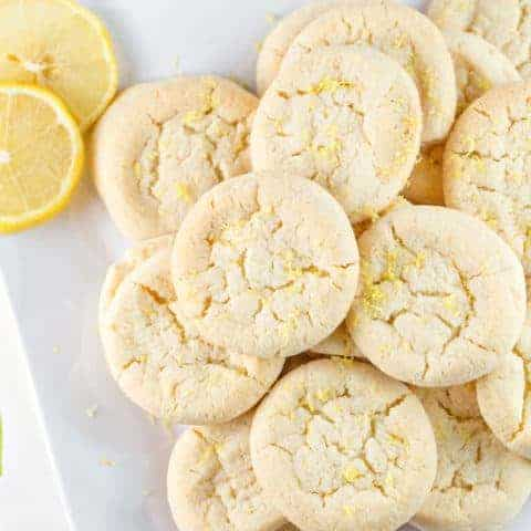 Lemon Sugar Cookies: perfectly soft and chewy, these cookies are made with 100% real lemon - no lemon cake mix or pudding. #bunsenburnerbakery #cookies #sugarcookies #lemon